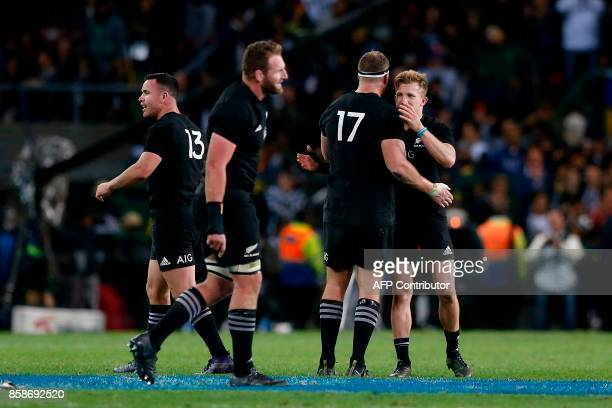 New Zealand team celebrates after winning the Rugby test match between South Africa and New Zealand at Newlands Rugby stadium on October 7 2017 in...
