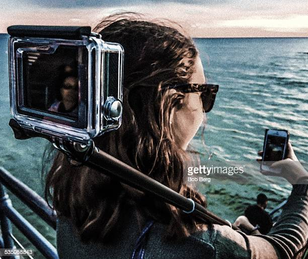 Santa Monica Ca January 22 2015 A New Zealand tourist 'Olivia' is multi photoing with a selfie stick and smartphone on the Santa Monica Pier