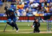 New Zealand wicketkeeper Luke Ronchi fails to collect a throw in a bid to run out Angelo Mathews of Sri Lanka during the ICC Champions Trophy group A...