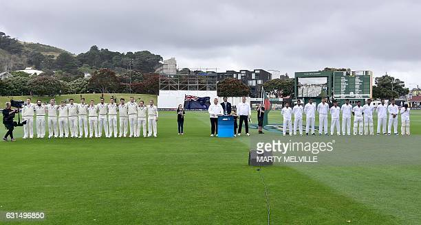 New Zealand with Bangladesh stand for their national anthems during the day one of the first international Test cricket match match between New...