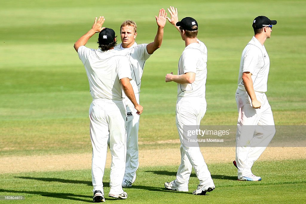 New Zealand XI celebrate a wicket during day two of the International tour match between the New Zealand XI and England at Queenstown Events Centre on February 28, 2013 in Queenstown, New Zealand.