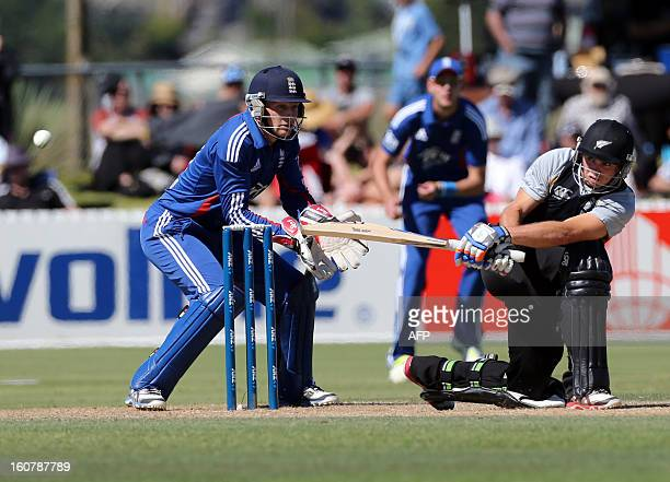 New Zealand XI's Tom Latham bats as England's wicket keeper Jos Buttler looks on during the warm up Twenty20 cricket match between the New Zealand XI...