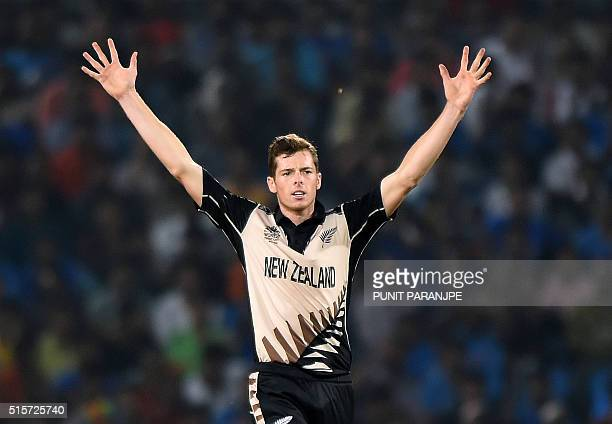 New Zealander bowler Mitchell Santner celebrates after the wicket of India's batsman Hardik Pandya during the World T20 cricket tournament match...