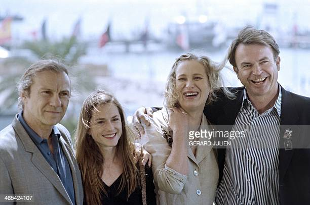 New Zealander film director Jane Campion poses with actors Harvey Keitel Holly Hunter and Sam Neill on May 17 during a photocall for the film 'The...