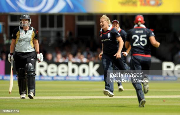 New Zealand's Aimee Watkins leaves the field after being bowled by England's Katherine Brunt who celebrates during the Final of the Womens ICC World...