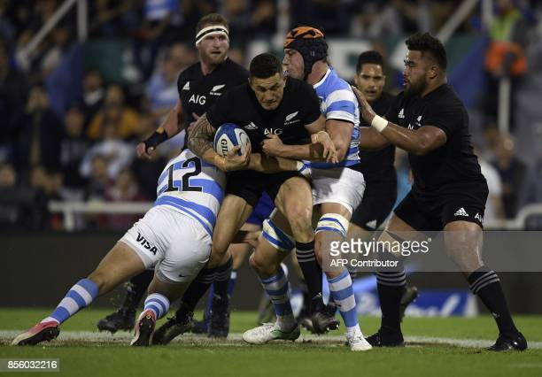 New Zealand's All Blacks centre Sonny Bill Williams is tackled by Argentina's Los Pumas lock Guido Petti and centre Jeronimo De La Fuente during...