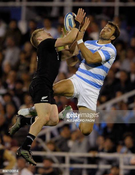 New Zealand's All Blacks fullback Damian McKenzie and Argentina's Los Pumas flyhalf Juan Martin Hernandez vie for the ball during Rugby Championship...
