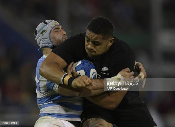 New Zealand's All Blacks lock Patrick Tuipulotu is tackled by Argentina's Los Pumas Juan Manuel Leguizamon during their Rugby Championship match at...