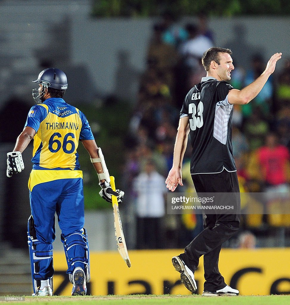 New Zealand's Andrew Ellis (R) celebrates after he dismissed Sri Lankan cricketer Lahiru Thirimanne (L) during the fourth One Day International (ODI) match between Sri Lanka and New Zealand at the Mahinda Rajapaksa International Cricket Stadium in Hambantota on November 10, 2012.