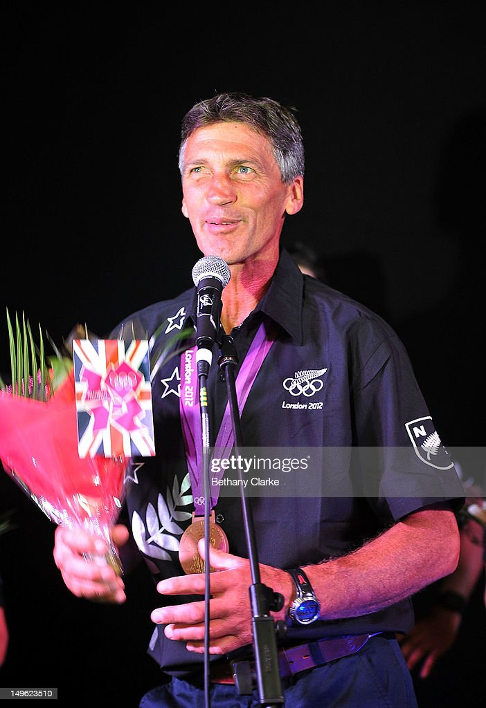 New Zealand's Andrew Nicholson gives a speech as he receives flowers during a Visit Kiwi House on August 1, 2012 in London, England. New Zealand won their first medal at the London Olympics after they picked up bronze in the team's competition of the three-day eventing.