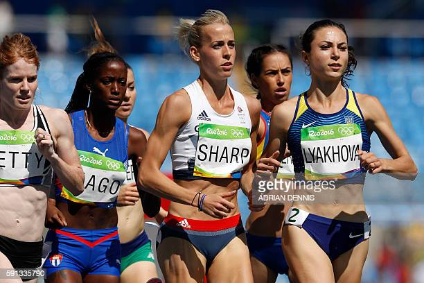 New Zealand's Angie Petty Cuba's Sahily Diago Britain's Lynsey Sharp and Ukraine's Olha Lyakhova compete in the Women's 800m Round 1 during the...