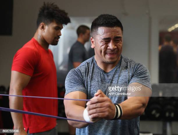 New Zealand's Asafo Aumua takes part in an All Blacks team training session in the gym at the Lensbury Hotel in Teddington southwest London on...