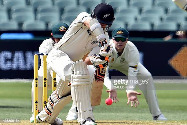 New Zealand's batsman Tom Latham plays a defensive shot during the first daynight cricket Test match at the Adelaide Oval against Australia on...