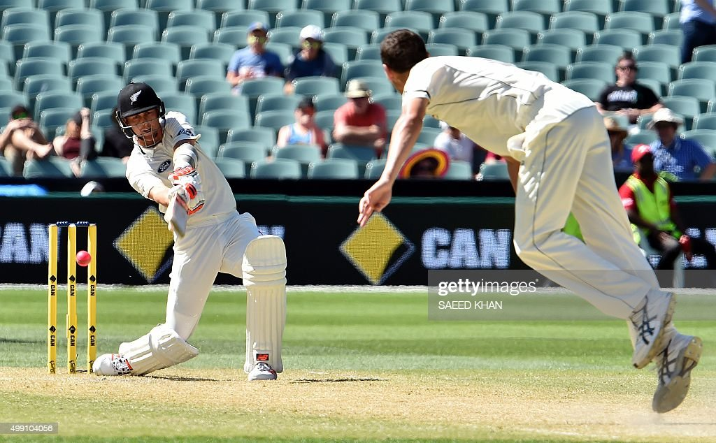 New Zealand's batsman Trent Boult is clean bowled off Australia's paceman Jash Hazlewood during the third day of the daynight cricket Test match at...
