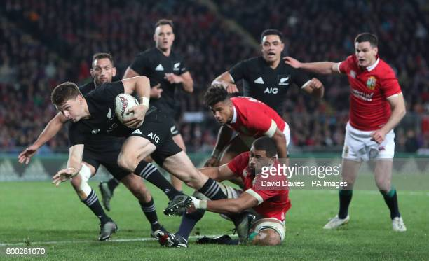 New Zealand's Beauden Barrett is tackled by British and Irish Lions' Taulupe Faletau during the first test of the 2017 British and Irish Lions tour...
