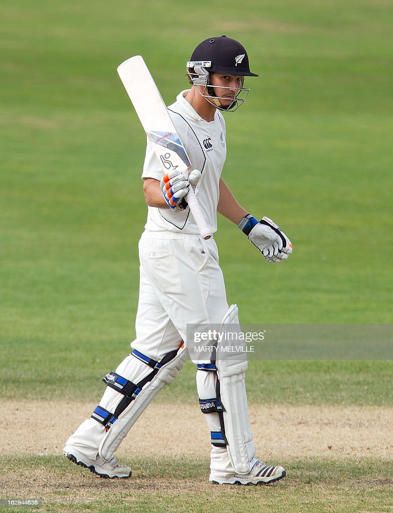 New Zealand's BJ Watling celebrates 50 runs on the last day of the four day warm-up international cricket match between New Zealand XI and England in Queenstown on March 2, 2013. AFP PHOTO / Marty MELVILLE