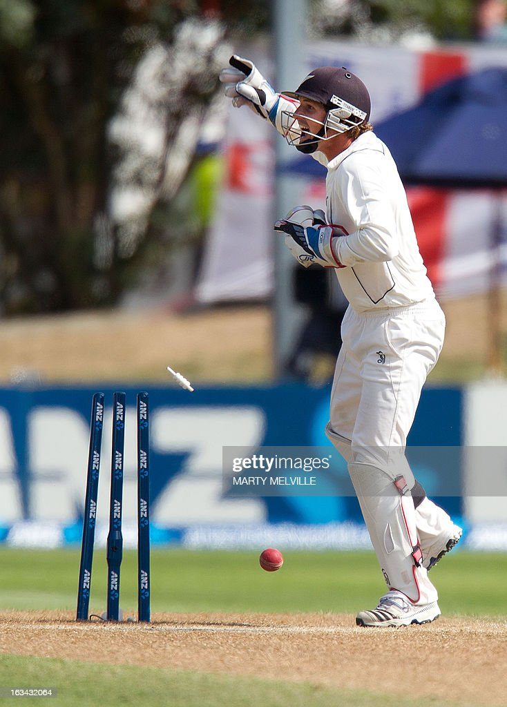 New Zealand's BJ Watling celebrates as England's Joe Root (unseen) is run out during day four of the first international cricket test match between New Zealand and England played at the University Oval park in Dunedin on March 10, 2013. AFP PHOTO / Marty MELVILLE