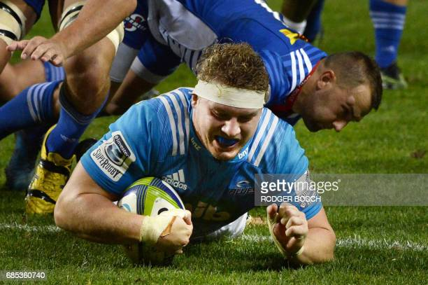 New Zealand's Blues' Blake Gibson scores a try during the Super Rugby match New Zealand's Blues against South Africa's Stormers on May 19 2017 at...