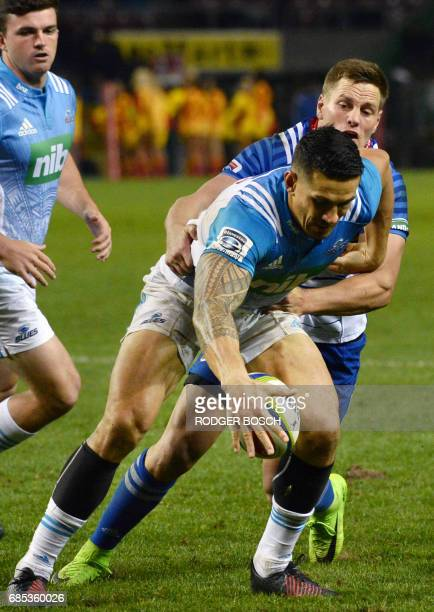 New Zealand's Blues' Sonny Bill Williams fumbles the ball during the Super Rugby match New Zealand's Blues against South Africa's Stormers on May 19...