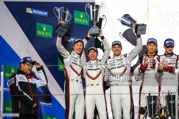 New Zealand's Brendon Hartley Germany's Timo Bernhard and New Zealand's Earl Bamber celebrate with their trophies on the podium after winning the FIA...