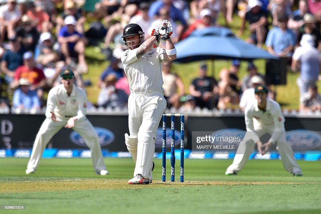 New Zealand's Brendon McCullum (C plays a shot during day one of the first cricket international five-day Test match between New Zealand and Australia at Basin Reserve in Wellington on February 12, 2016. / AFP / Marty Melville