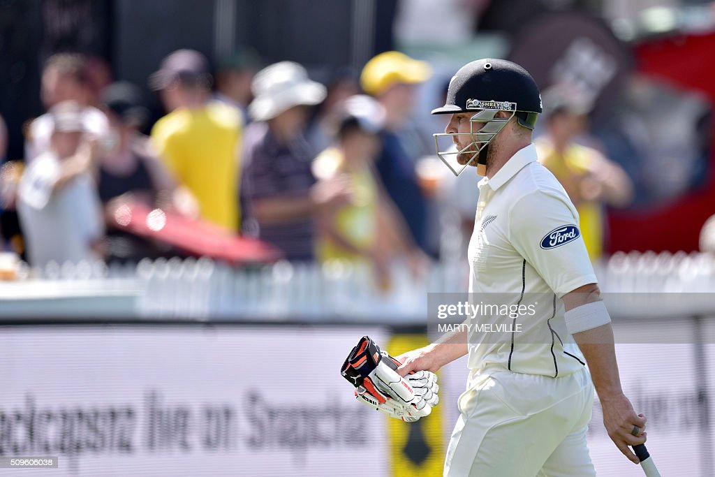 New Zealand's Brendon McCullum walks from the field after being caught during day one of the first cricket international five-day Test match between New Zealand and Australia at Basin Reserve in Wellington on February 12, 2016. AFP PHOTO / MARTY MELVILLE / AFP / Marty Melville