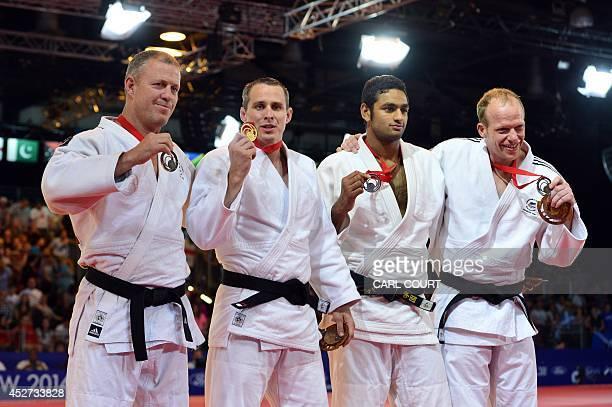 New Zealand's bronze medalist Tim Slyfield Scotland's gold medalist Euan Burton Pakistan's silver medalist Shah Hussain Shah and New Zealand's bronze...