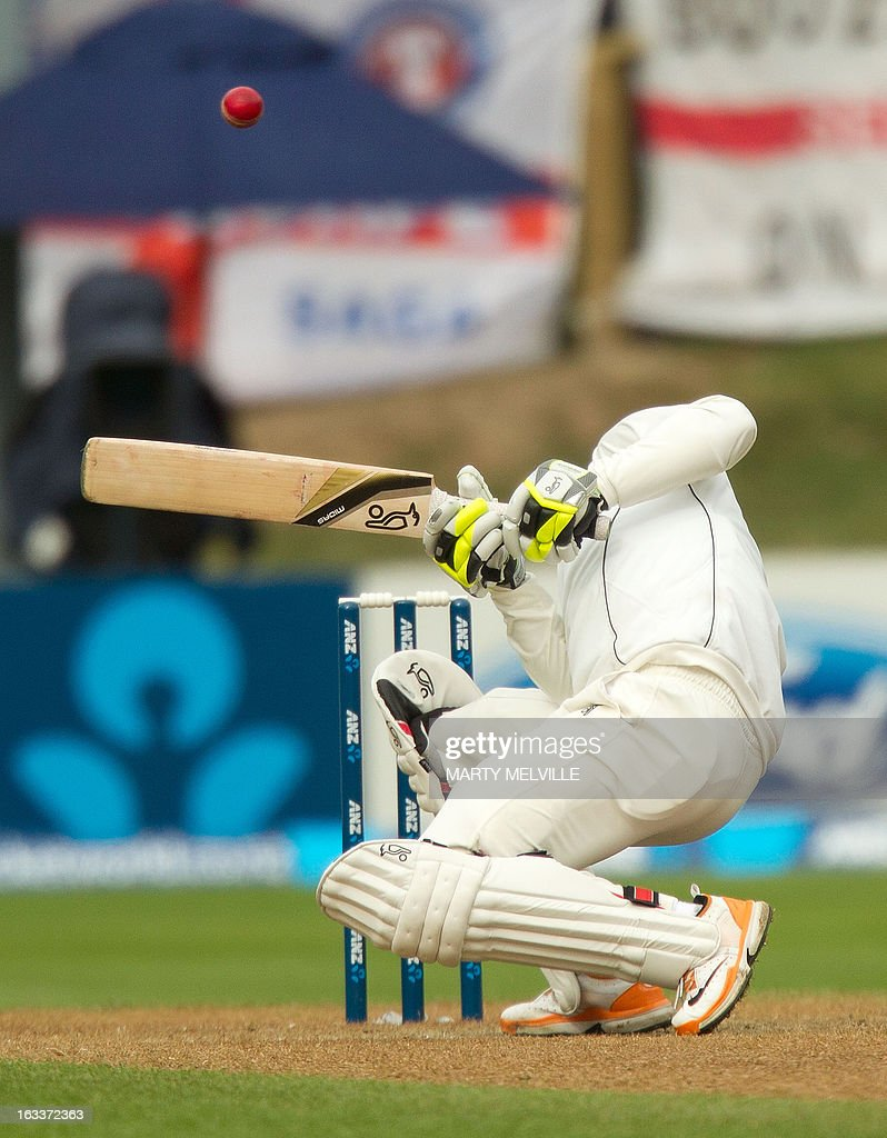 New Zealand's Bruce Martin ducks a bouncer during day four of the first international cricket test match between New Zealand and England played at the University Oval park in Dunedin on March 09, 2013. AFP PHOTO / Marty MELVILLE