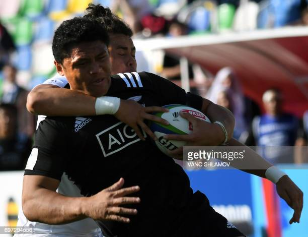 New Zealand's Caleb Daniel Clarke is tackled by England's Jacob Ionatana Falefasa Umaga during the 2017 World Rugby U20 Championship final match...