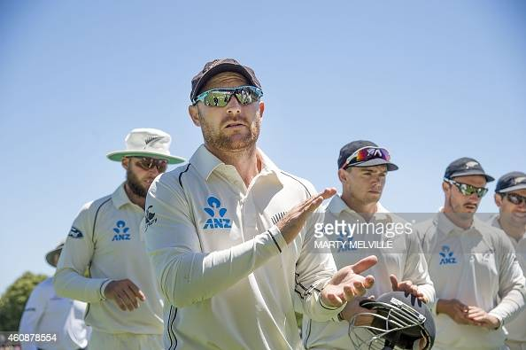 New Zealand's captain Brendon McCullum leads his team from the field at the end of the Sri Lankan innings during day four of the first International...