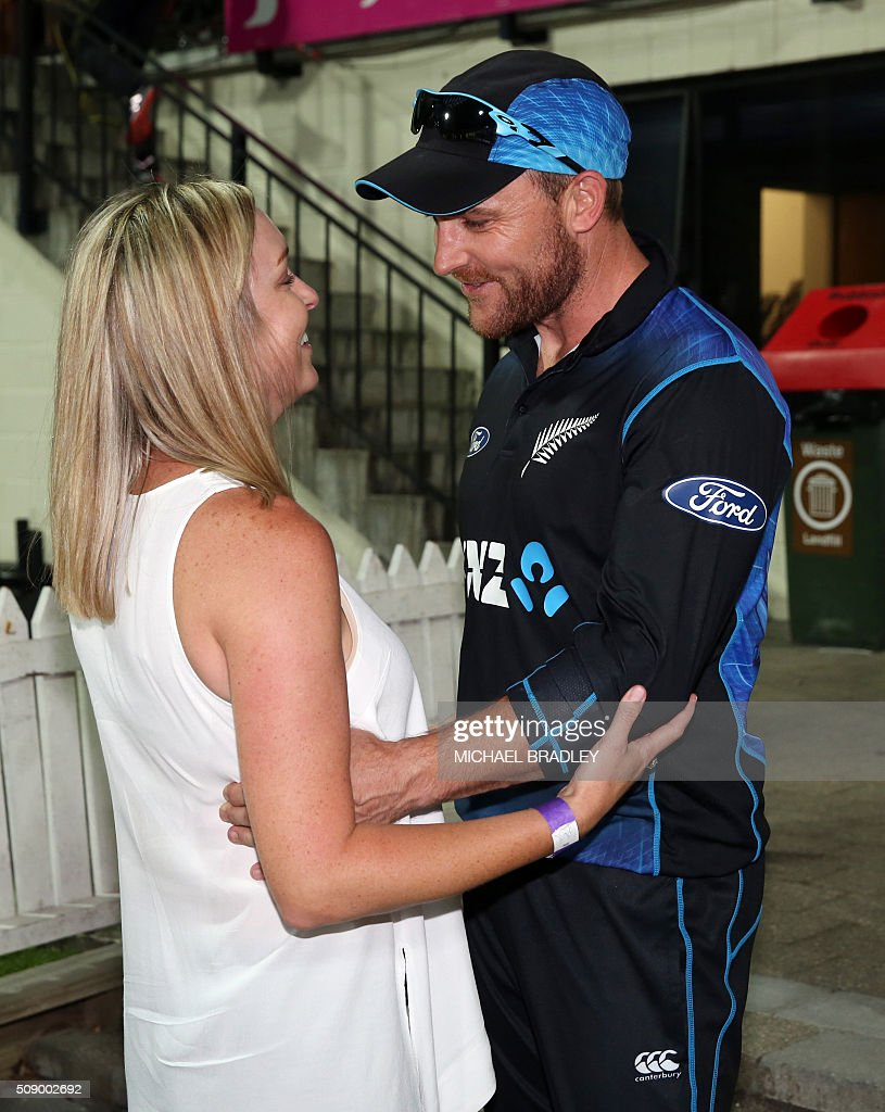New Zealand's captain Brendon McCullum (R) with his wife Ellissa interact after the third one-day international cricket match between New Zealand and Australia at Seddon Park in Hamilton on February 8, 2016.   AFP PHOTO / MICHAEL BRADLEY / AFP / MICHAEL BRADLEY