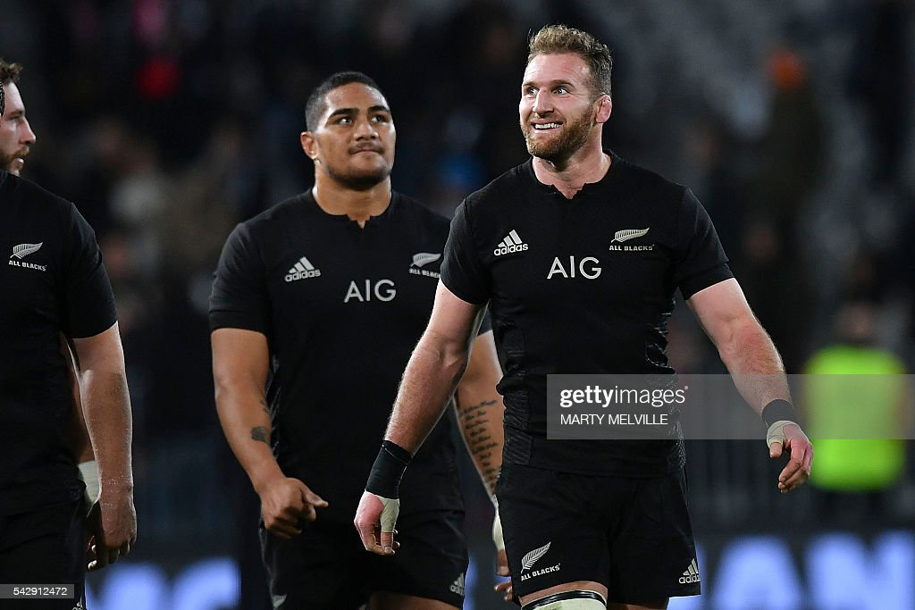 New Zealand's captain Kieran Read (R) celebrates their win with teammate Ofa Tu'ungafasi (C) at the end of the third rugby union Test match between the New Zealand All Blacks and Wales at Forsyth Barr Stadium in Dunedin on June 25, 2016. / AFP / Marty Melville