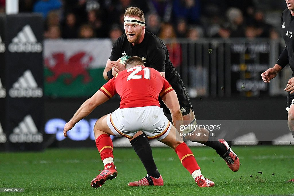 New Zealand's captain Kieran Read (facing) is tackled by Gareth Davies of Wales during the third rugby union Test match between the New Zealand All Blacks and Wales at Forsyth Barr Stadium in Dunedin on June 25, 2016. / AFP / Marty Melville