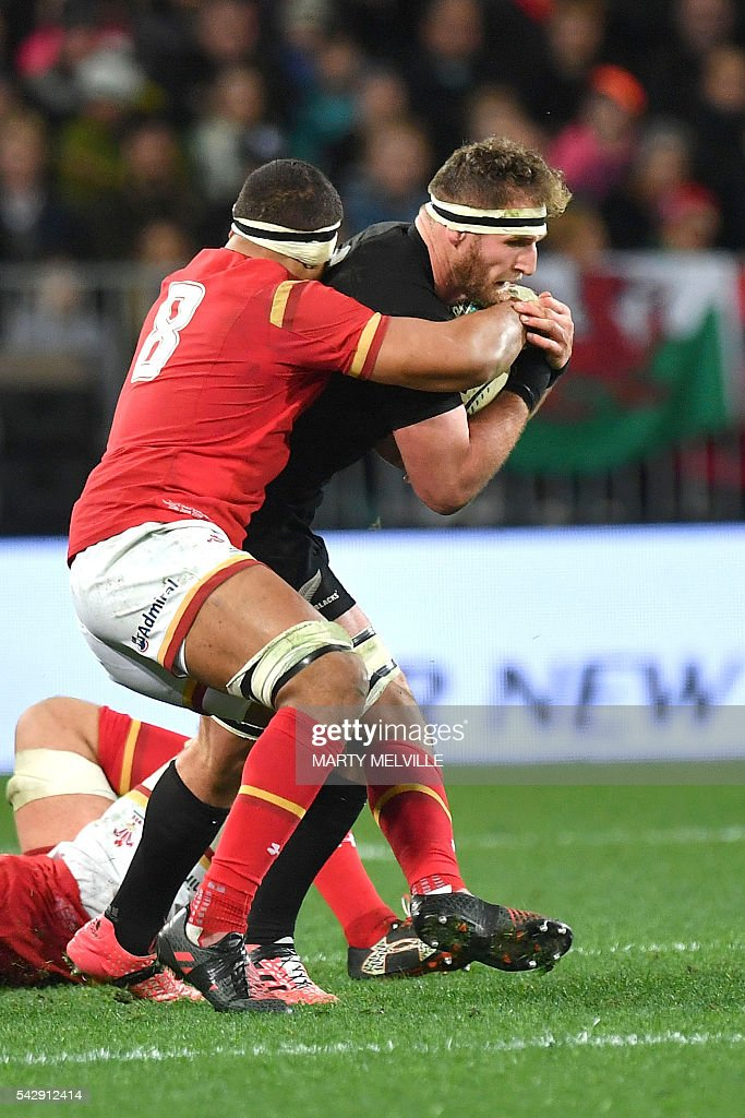New Zealand's captain Kieran Read (R) is tackled by Taulupe Faletau of Wales (L) during the third rugby union Test match between the New Zealand All Blacks and Wales at Forsyth Barr Stadium in Dunedin on June 25, 2016. / AFP / Marty Melville