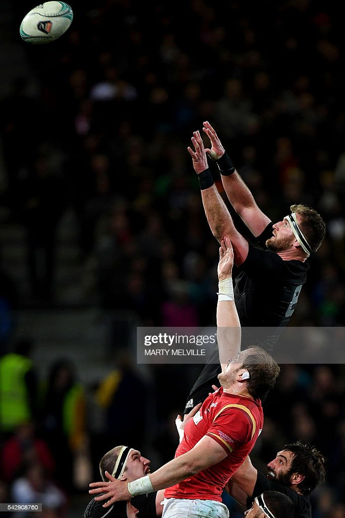 New Zealand's captain Kieran Read (top R) takes the lineout ball with Alun Wyn Jones of Wales (C) during the third rugby union Test match between the New Zealand All Blacks and Wales at Forsyth Barr Stadium in Dunedin on June 25, 2016. / AFP / Marty Melville