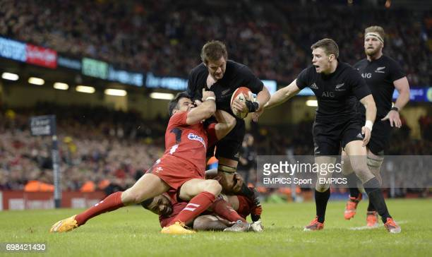 New Zealands captain Richie McCaw attempts to evade tackles from Wales Mike Phillips and Taulupe Faletau