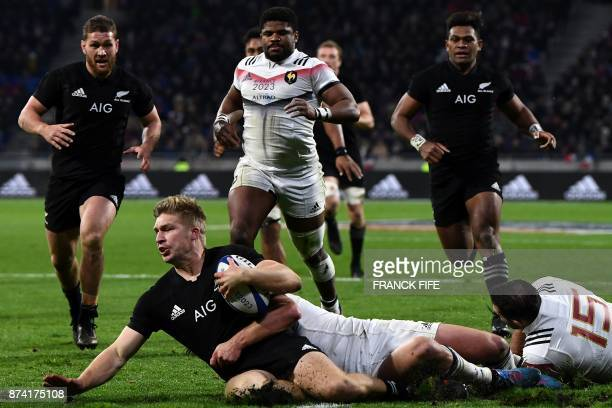 New Zealand's centre Jack Goodhue is tackled during the international rugby union test match between France and the New Zealand All Blacks at...
