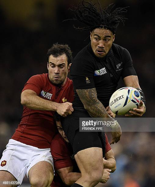 New Zealand's centre Ma'a Nonu is tackled during a quarter final match of the 2015 Rugby World Cup between New Zealand and France at the Millennium...