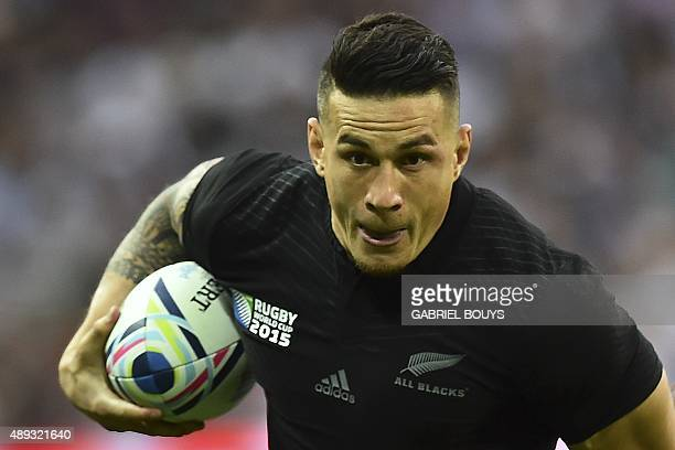 New Zealand's centre Sonny Bill Williams runs with the ball during a Pool C match of the 2015 Rugby World Cup between New Zealand and Argentina at...
