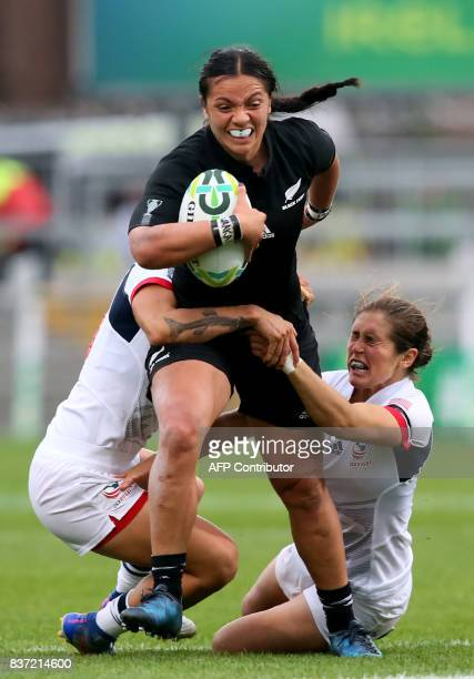 New Zealand's centre Stacey Waaka is tackled by US prop Tiffany Faaee and US flyhalf Kimber Rozier during the Women's Rugby World Cup 2017 semifinal...