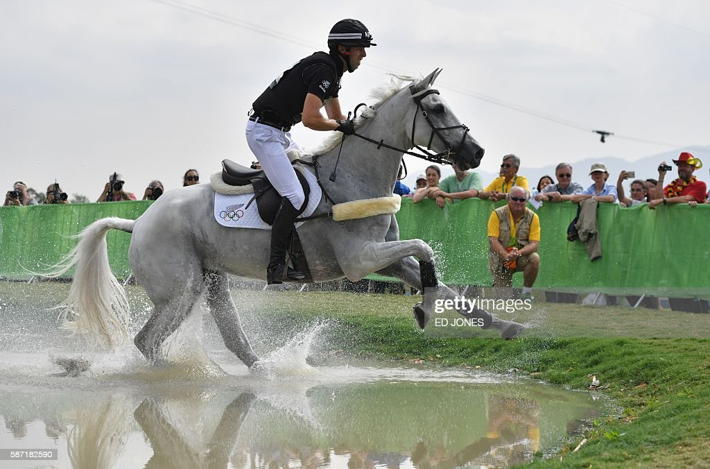 New Zealand's Clarke Johnstone on Balmoral Sensation competes in the Eventing's Individual Cross Country of the Equestrian during the 2016 Rio...
