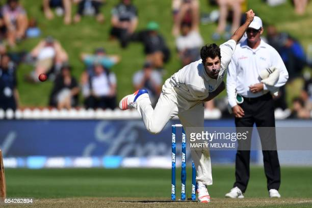 New Zealand's Colin De Grandhomme bowls during day two of the second Test cricket match between New Zealand and South Africa at the Basin Reserve in...