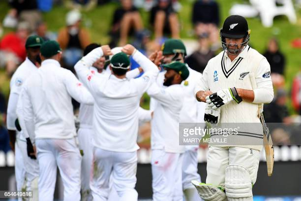 New Zealand's Colin De Grandhomme walks from the field after being bowled during day three of the second Test cricket match between New Zealand and...