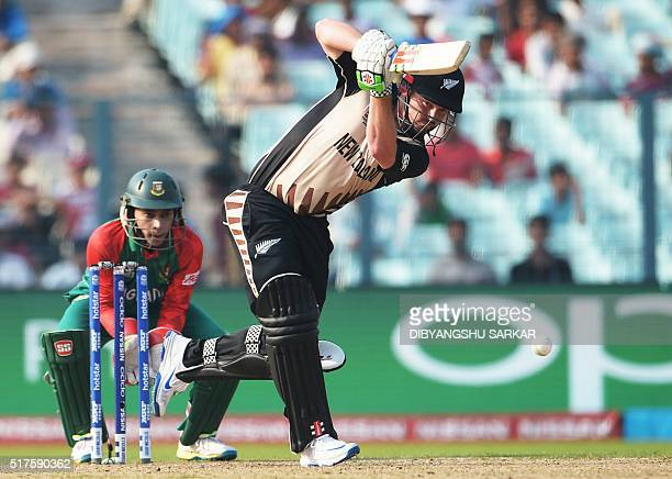 New Zealand's Colin Munro plays a shot during the World T20 cricket tournament match between Bangladesh and New Zealand at The Eden Gardens Cricket...