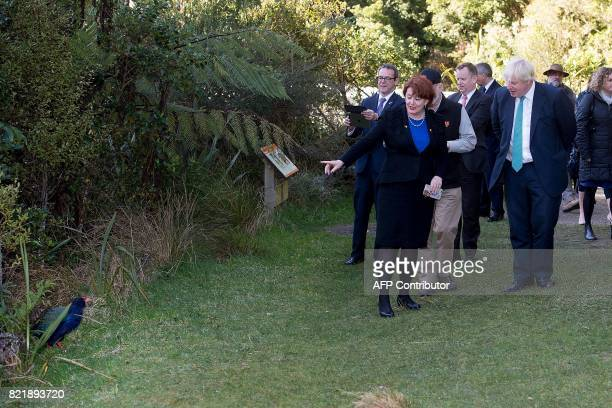 New Zealand's Conservation Minister Maggie Barry points out a South Island takahe to Britain's Foreign Secretary Boris Johnson during a visit to the...