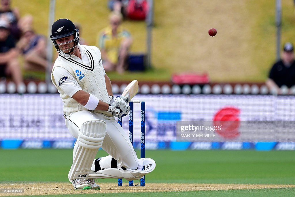 New Zealand's Corey Anderson dodges a bouncer during day four of the first cricket Test match between New Zealand and Australia at the Basin Reserve in Wellington on February 15, 2016. / AFP / Marty Melville