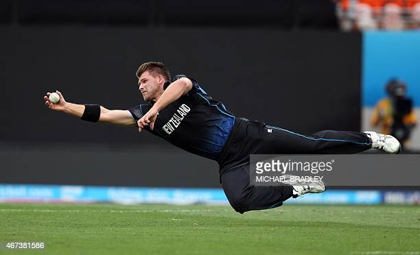 New Zealand's Corey Anderson fields off his own bowling during the semifinal Cricket World Cup match between New Zealand and South Africa played at...