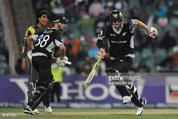 New Zealand's cricketer Daniel Vettori and Grant Elliott make runs off the ball of Pakistan's bowler Mohammad Aamir during ICC Champions Trophy 2nd...