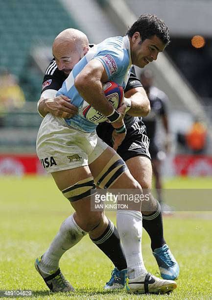 New Zealands D J Forbes tackles Argentina's Lucas de Vinceni during the Rugby Union England Sevens Cup match at Twickenham Stadium southwest London...