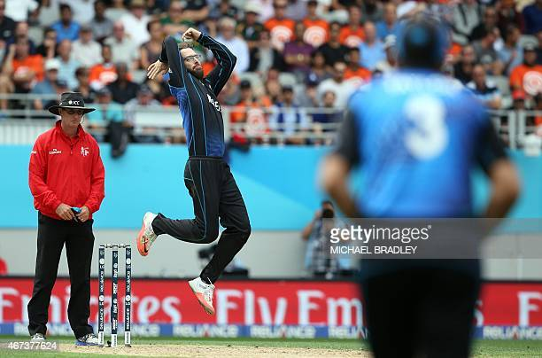 New Zealand's Daniel Vettori bowls during the semifinal Cricket World Cup match between New Zealand and South Africa played at Eden Park in Auckland...
